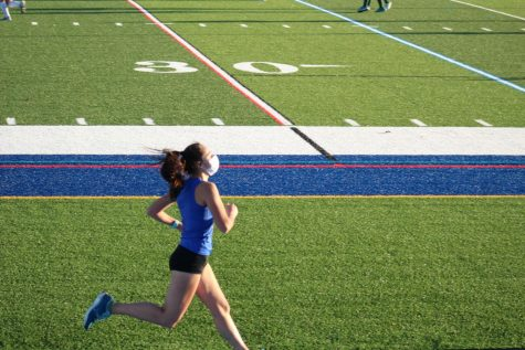 Cross Country senior Sarah Mandelkow competing in a home meet.