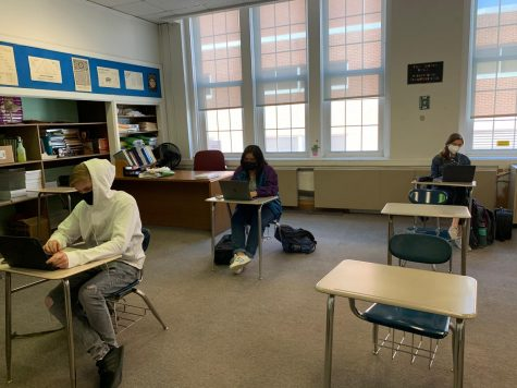 Students (Michael Mahoney, Katherine Mora,  Zoë Rose) in Mr. Tullos calculus class learn virtually, despite being present in school.