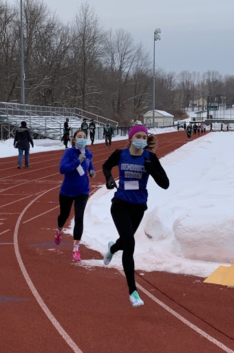 """Senior Zoë Rose competing in the 1000m race at an """"Indoor"""" Track meet this winter"""